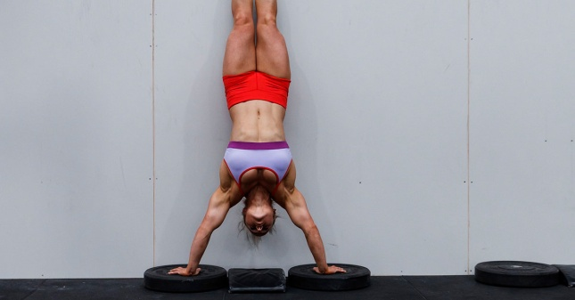 athlete-performing-handstand-push-ups