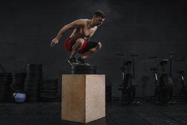crossfit-box-jump-exercise-athlete-260nw-1344552326